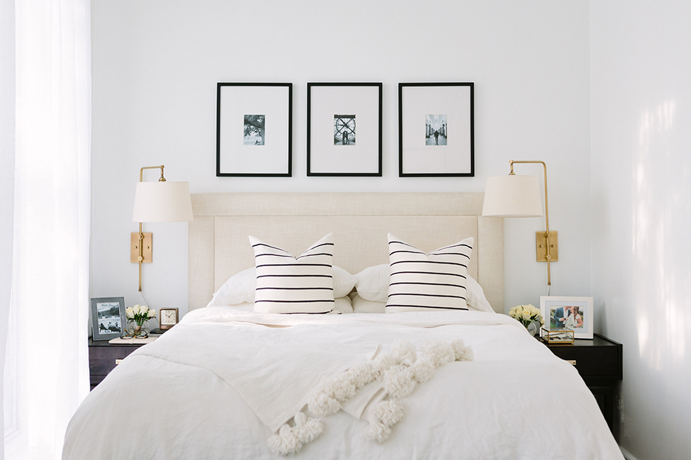 French-Inspired Bedroom with Gold Sconces