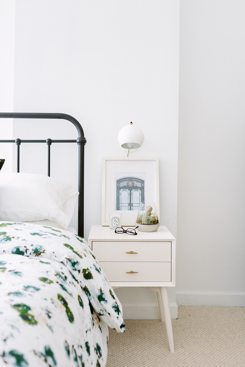 French-Inspired Guest Bedroom with Iron Headboard