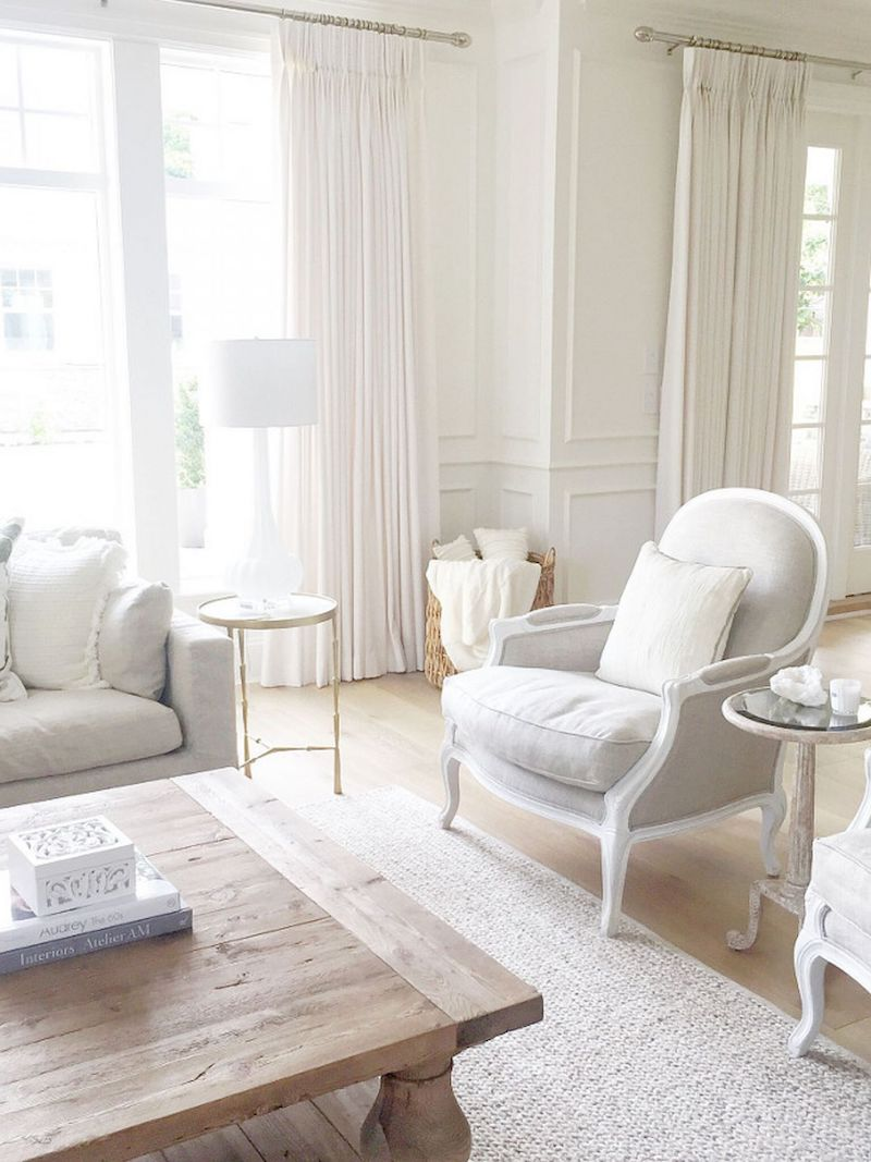 Grey and white bergere chair via Our Boat House