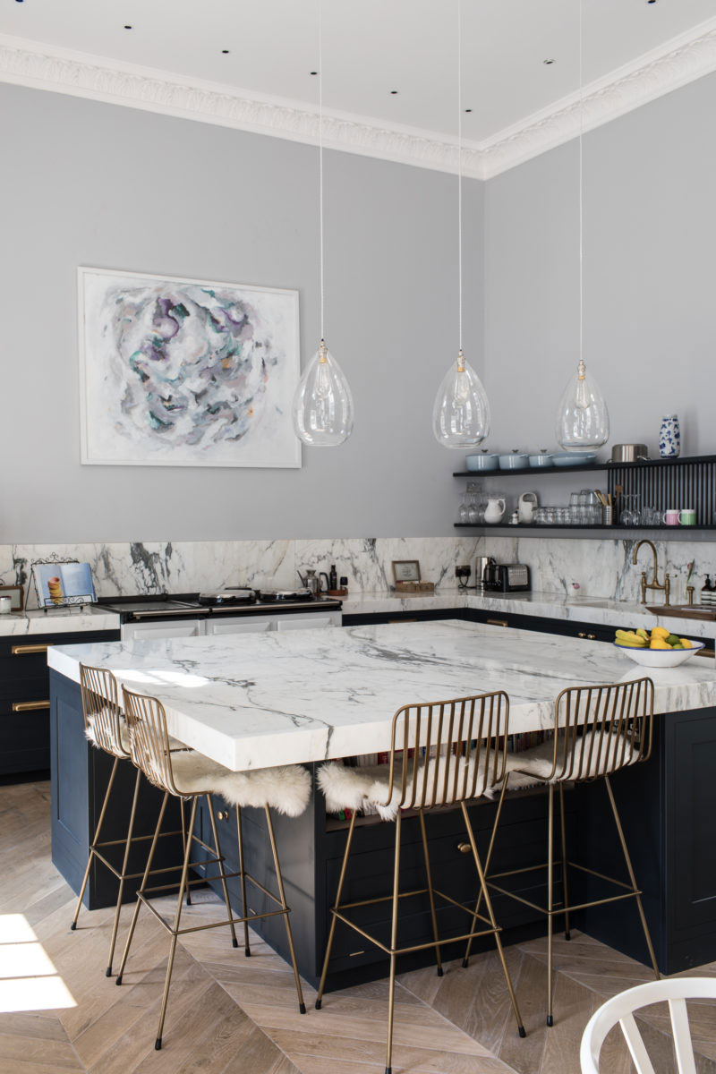 Marble Kitchen Island in Kitchen with Open Shelving Photo by Patrick Butler-Madden