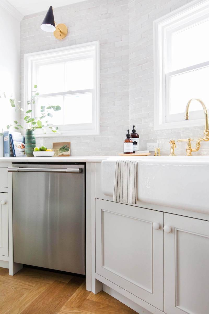 White farmhouse apron sink via Emily Henderson