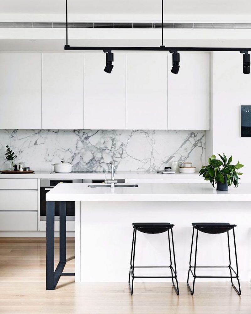 Black and white kitchen with white marble backsplash via Cortese Architects
