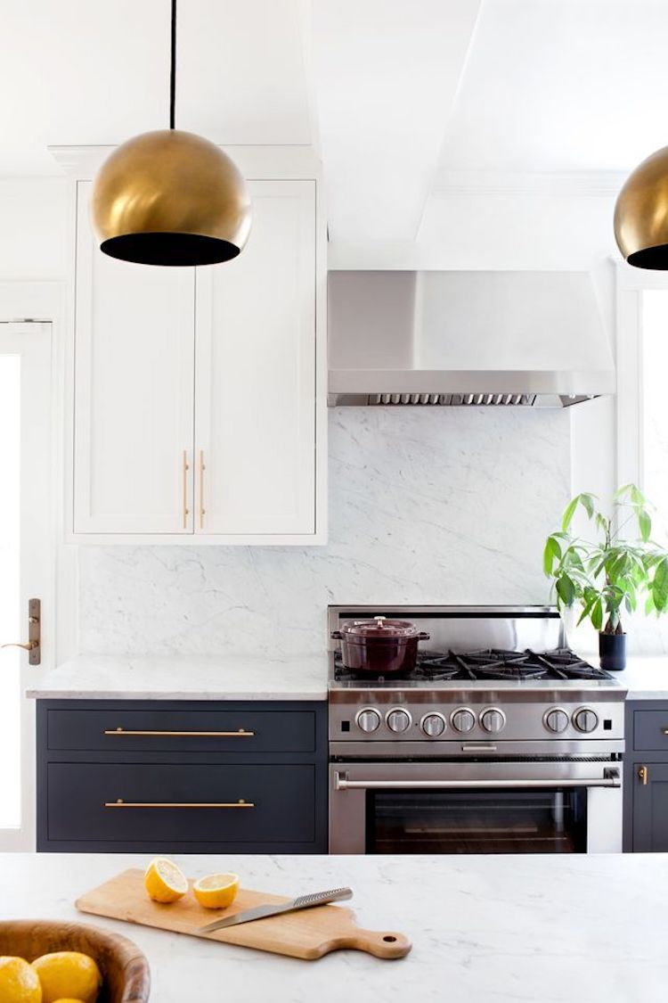 Brass kitchen with solid white marble backsplash via Jennifer Hughes