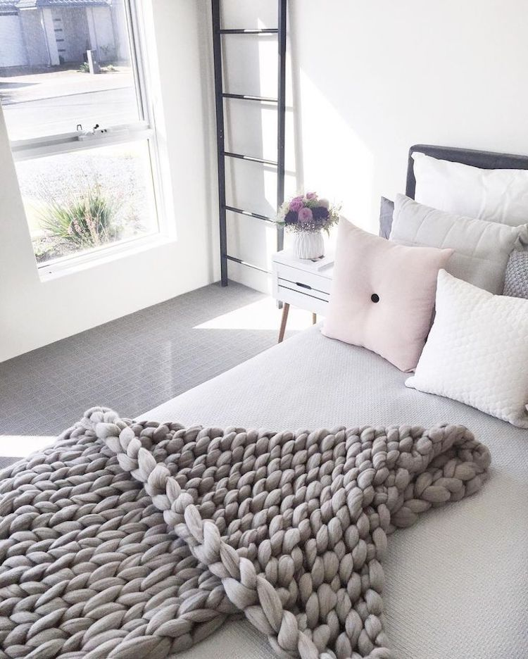 Grey chunky knit blanket in bedroom via @megcaris