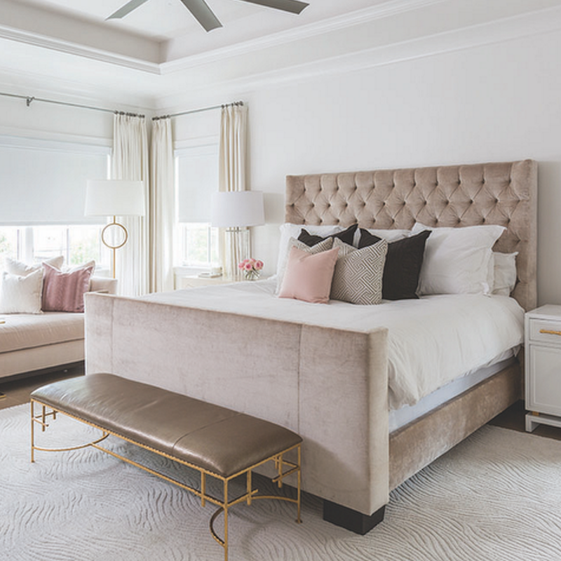 Neutral tufted headboard with end of bed bench