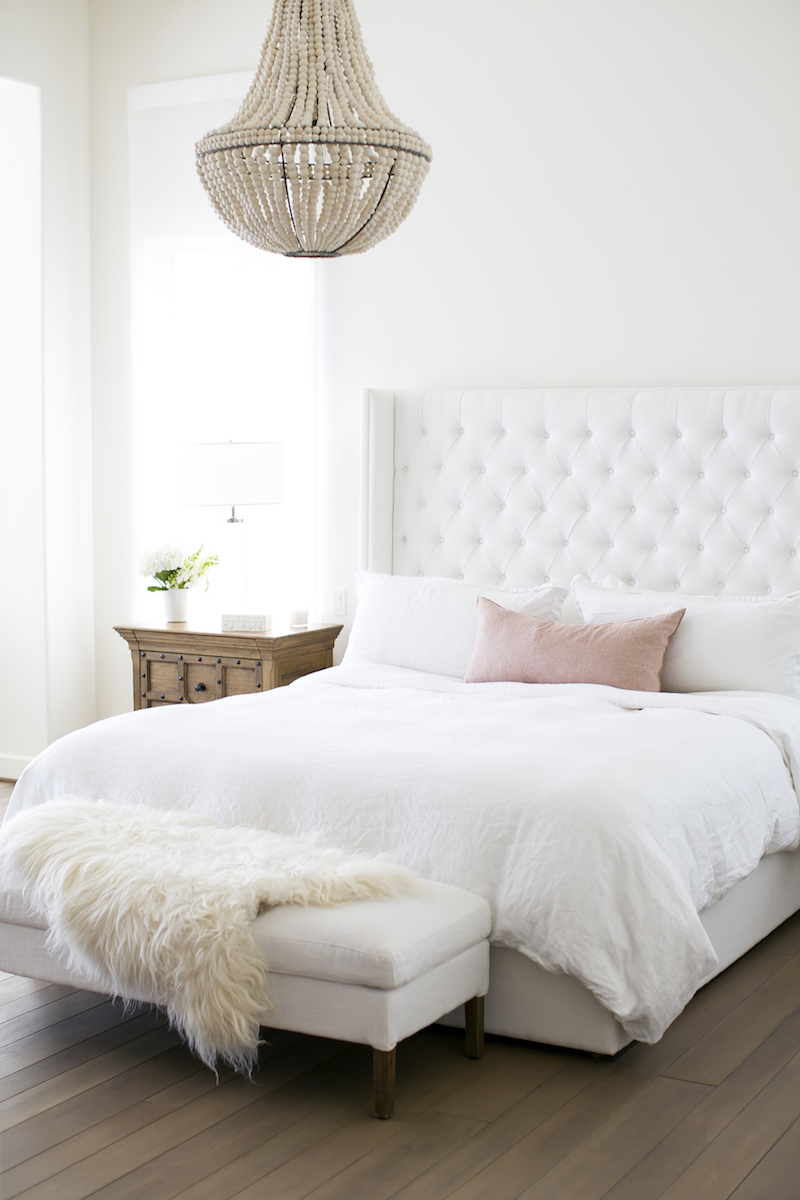 White bed with cream bench in bedroom via With Love From Kat