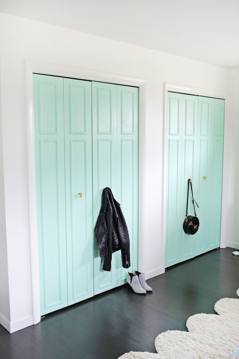 Mint green closet doors via A Beautiful Mess
