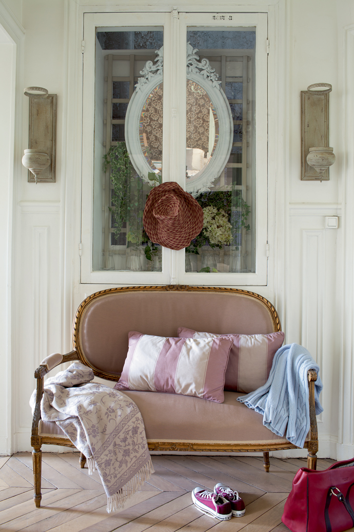 Louis style loveseat in vintage French parisian apartment