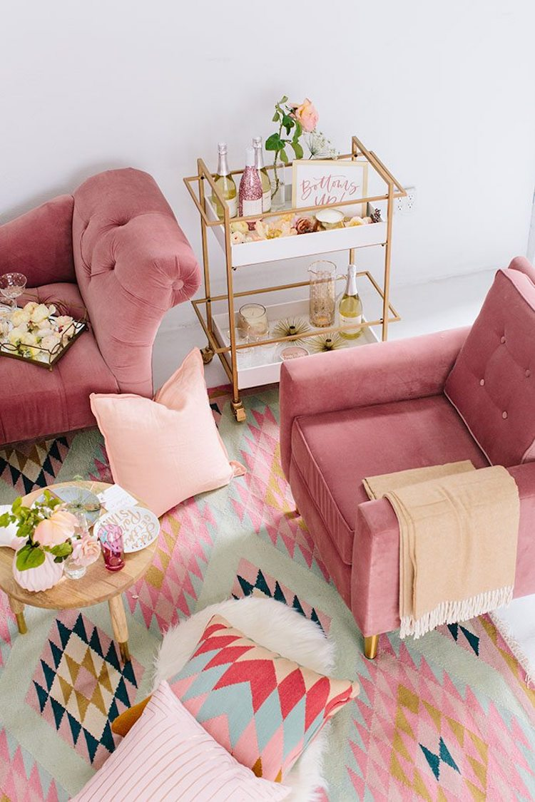 Pink tufted accent chair via Glitter Guide