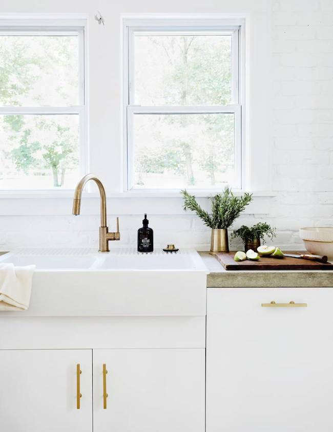 White farmhouse kitchen with brass hardware