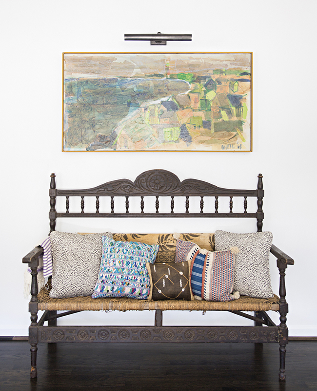 A brown country style bench in Sally King Benedict's Atlanta home
