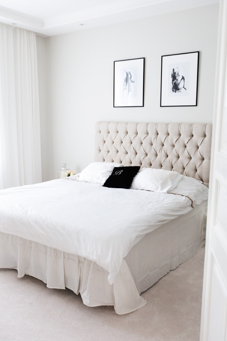 Alexa Dagmar Bedroom with tufted neutral headboard