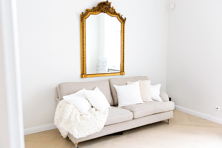 Alexa Dagmar Office with neutral couch and oversized gilded mirror