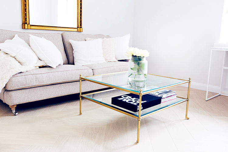 Alexa Dagmar office with glass and gold coffee table