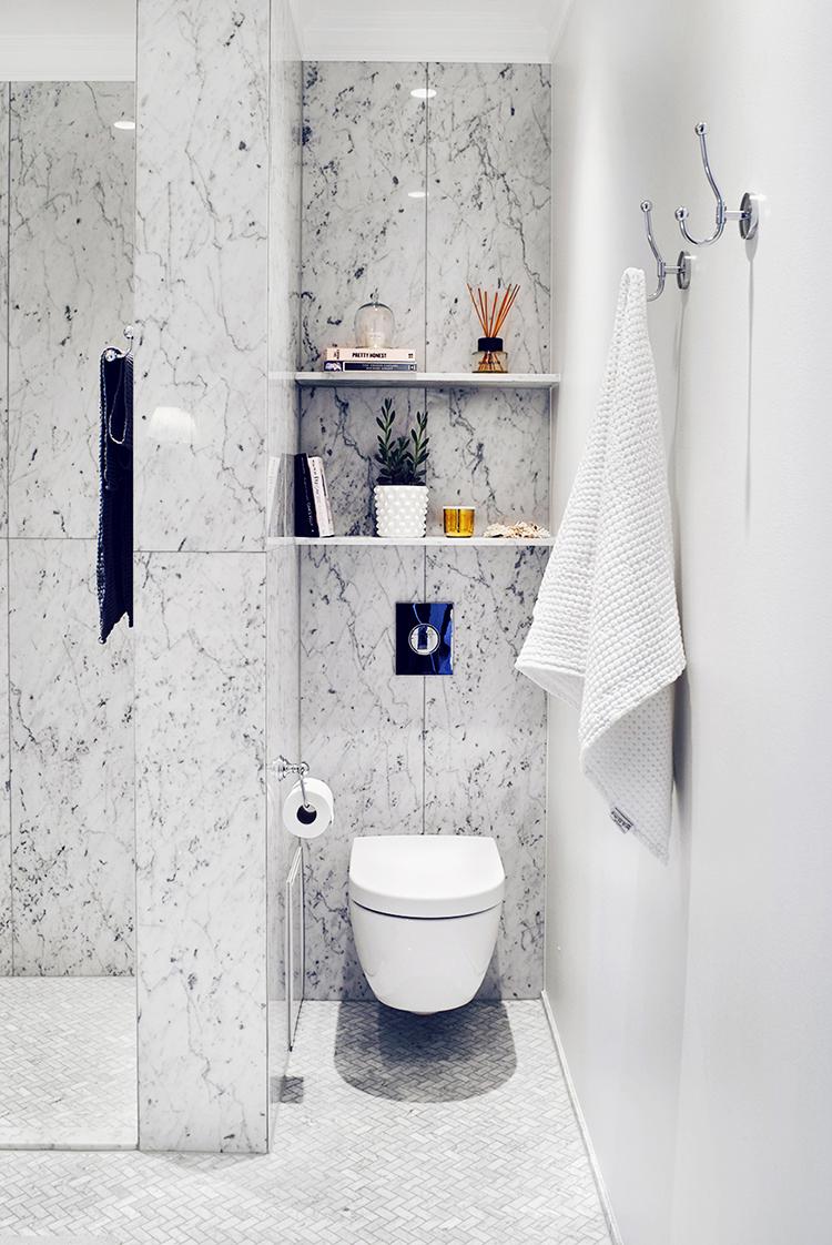 Alexa Dagmar scandinavian marble bathroom with marble walls