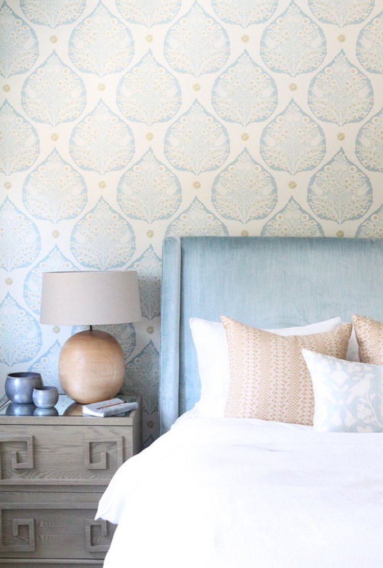 Bedroom with blue headboard design by Nicole Davis