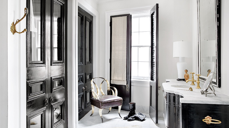 Black bathroom sink cabinets with marble countertop via Darryl Carter