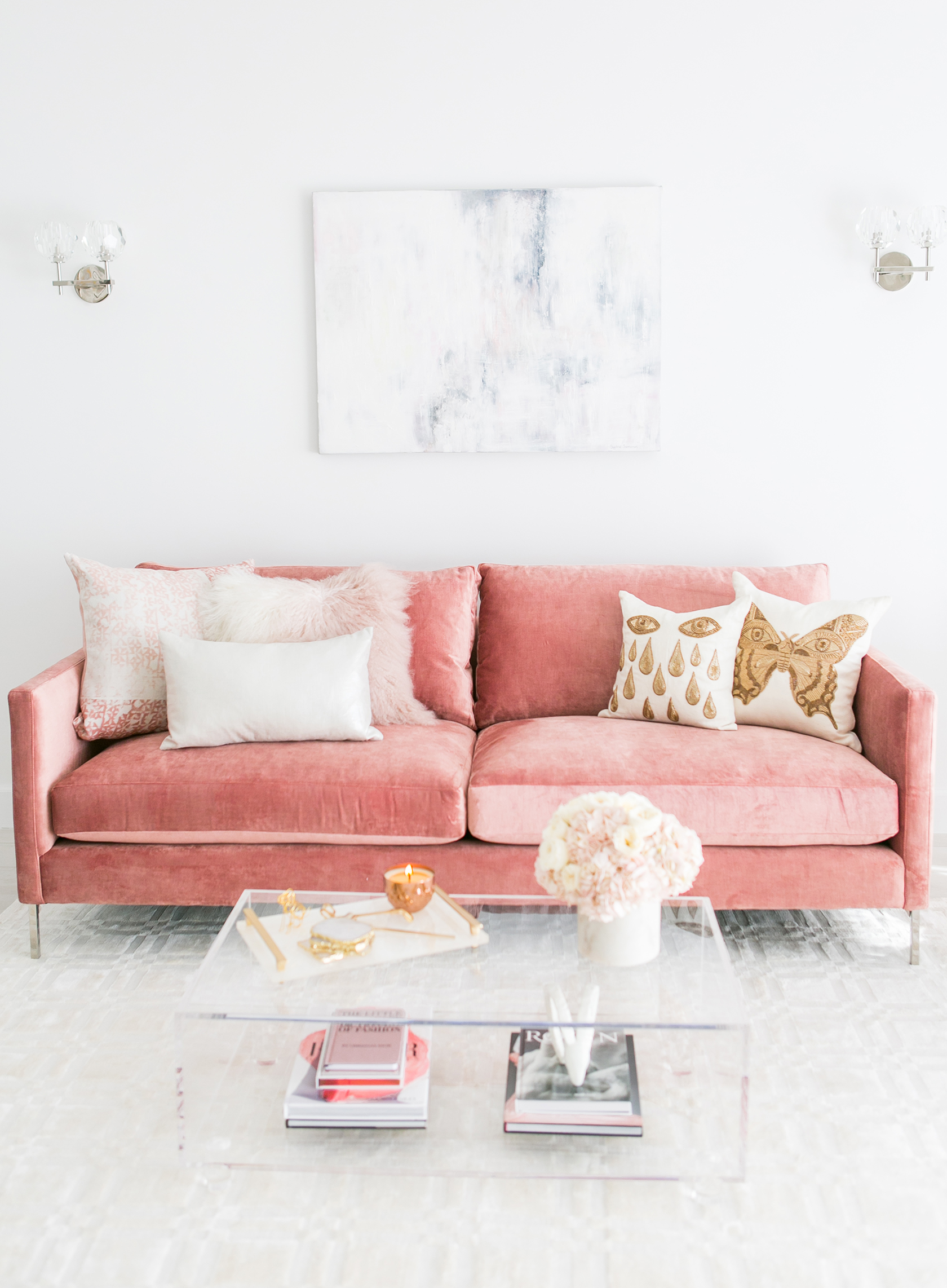 Blush pink couch with lucite coffee table via Sydne Summer