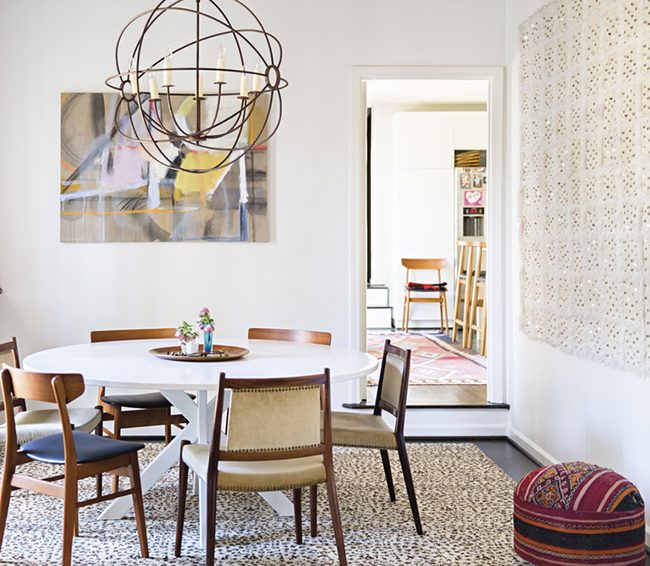 Brown mid-century dining chairs in Dining Room with circular cage lighting