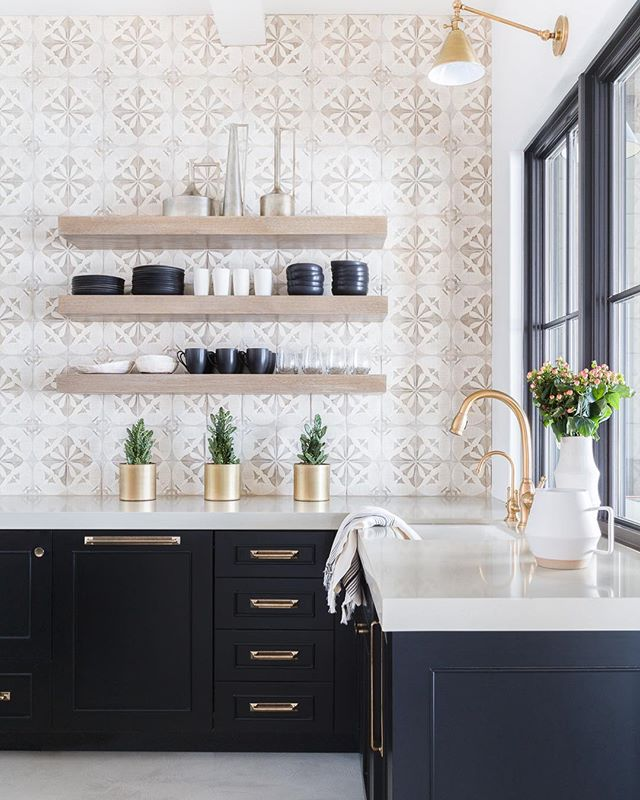 Kitchen with open shelving and black cabinets by Nicole Davis