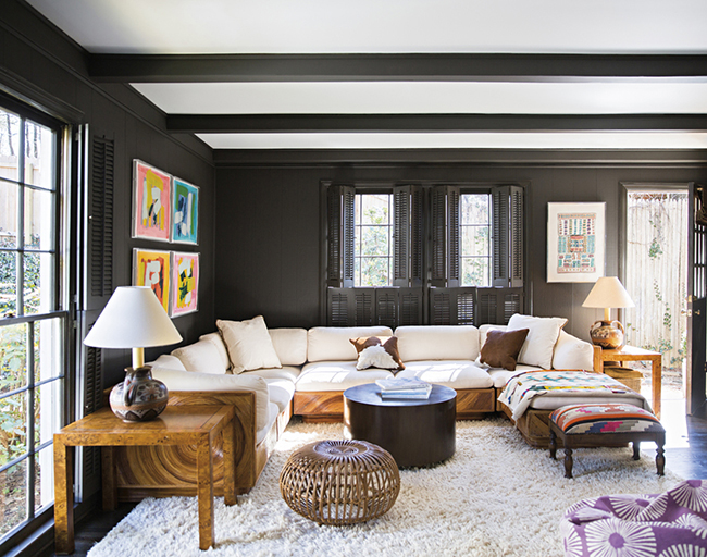 Living room with black walls and white fur rug