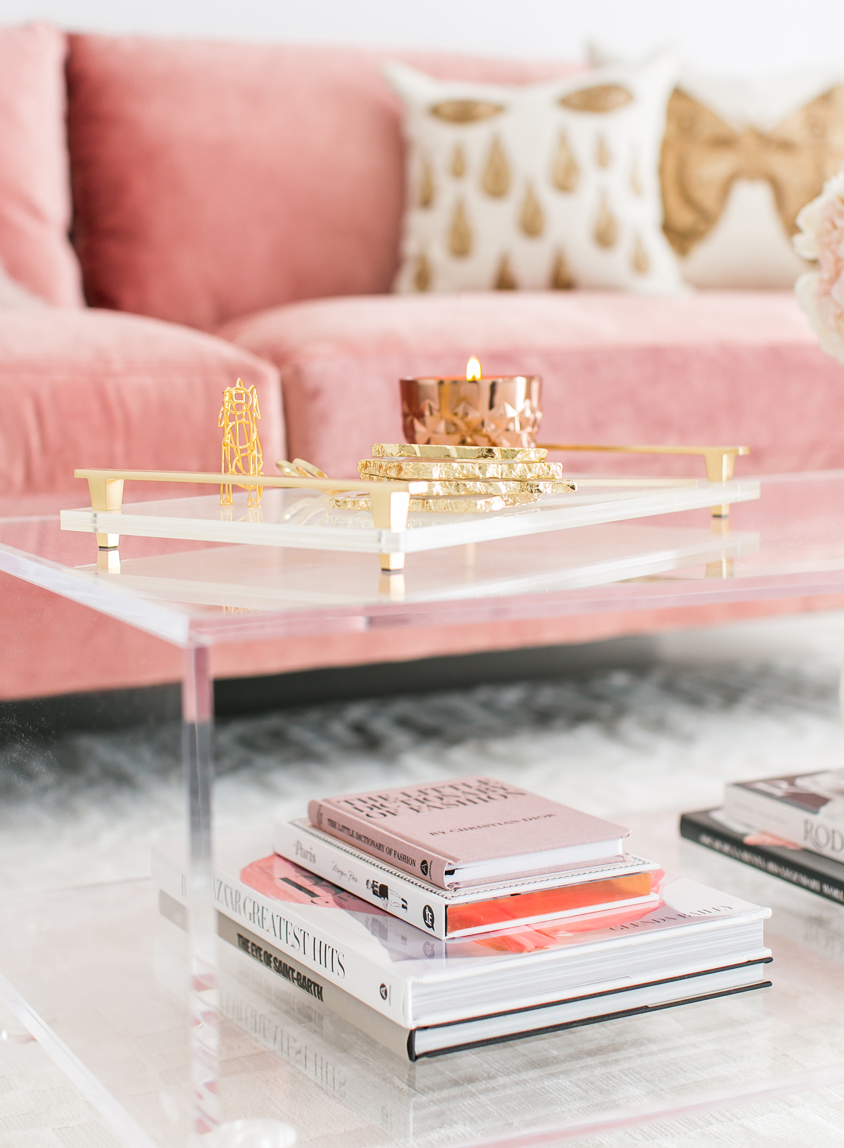 Lucite coffee table vignette with blush pink velvet sofa via Sydne Summer