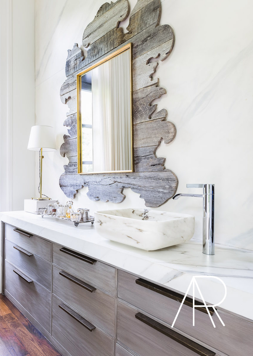 Marble vessel sinks in bathroom with wood frame mirror via Alyssa Rosenheck