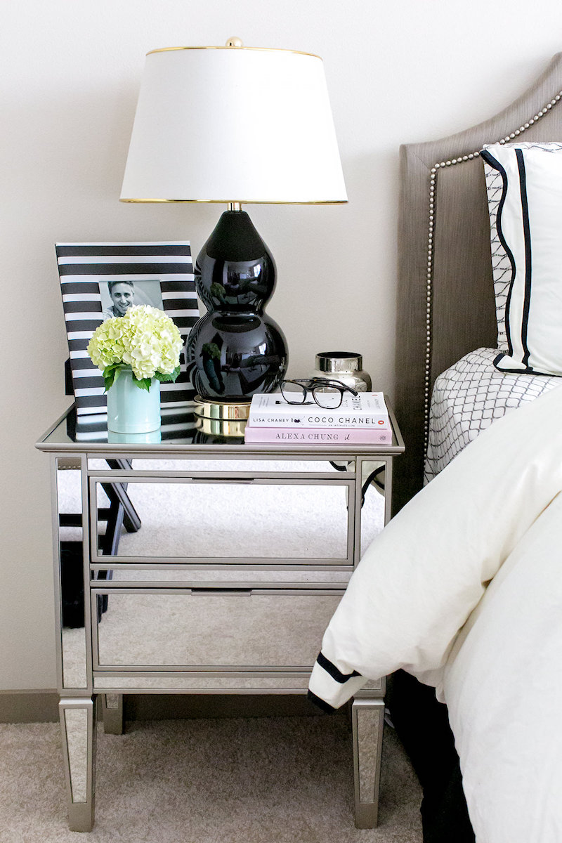 Mirrored nighstands with black table lamp via Nichole Ciotti