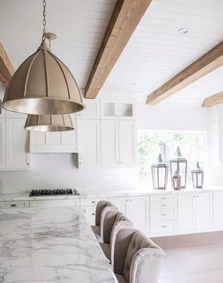 Open kitchen with marble island by Nicole Davis