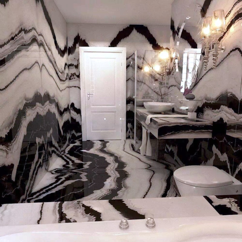 Panda white marble bathroom with white door