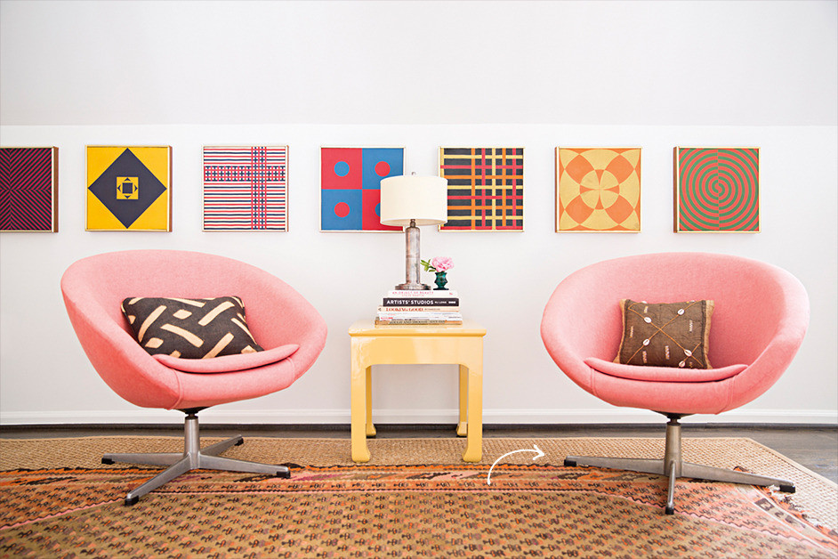 Pink 60s sitting chairs and abstract wall art