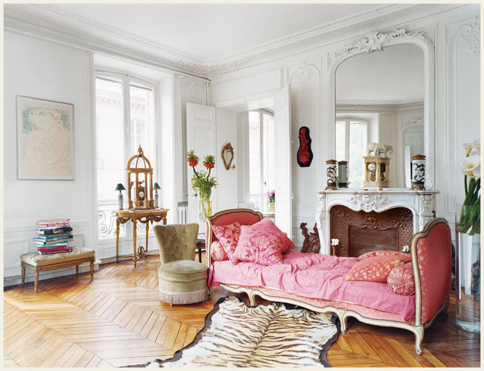Pink daybed and marble fireplace in Erin Fetherston's Dreamy Parisian Apartment