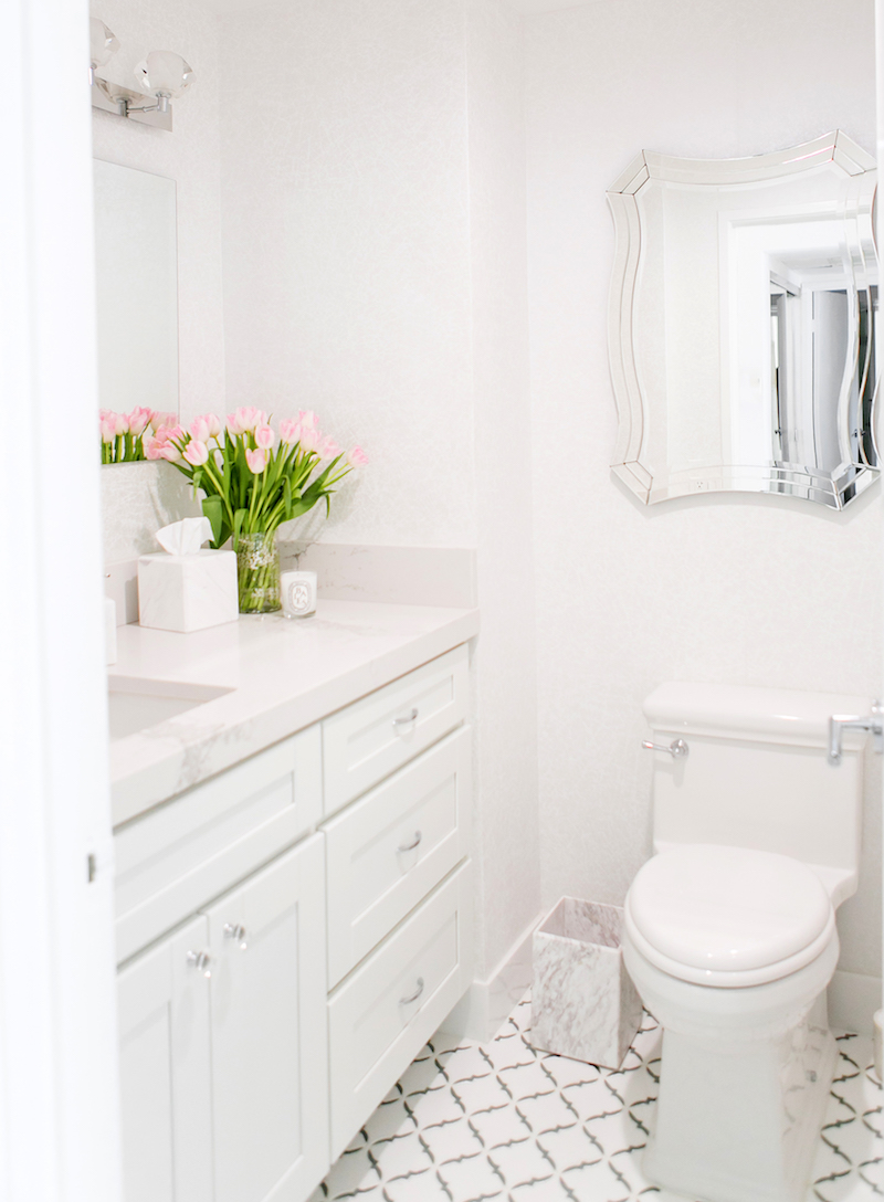 Pink tulips in white marble bathroom via Sydne Summer