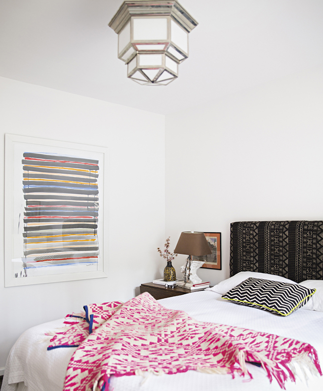 Sally King Benedict's Bedroom with hot pink and white throw, and silver flushmount