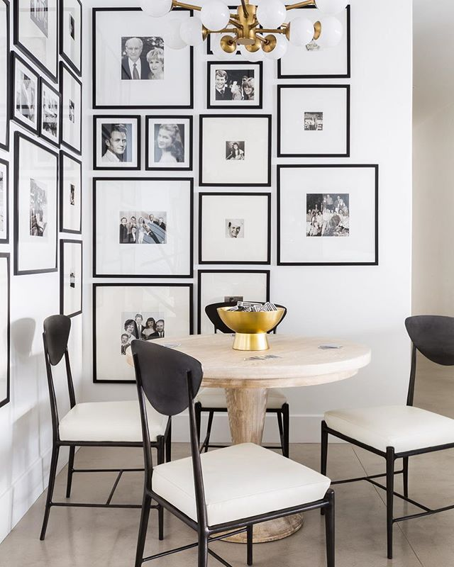 Salon style photos on wall behind breakfast nook design by Nicole Davis