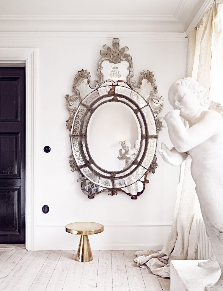 Scandinavian decor with mirror and sculpture via Marie Olsson Nylander