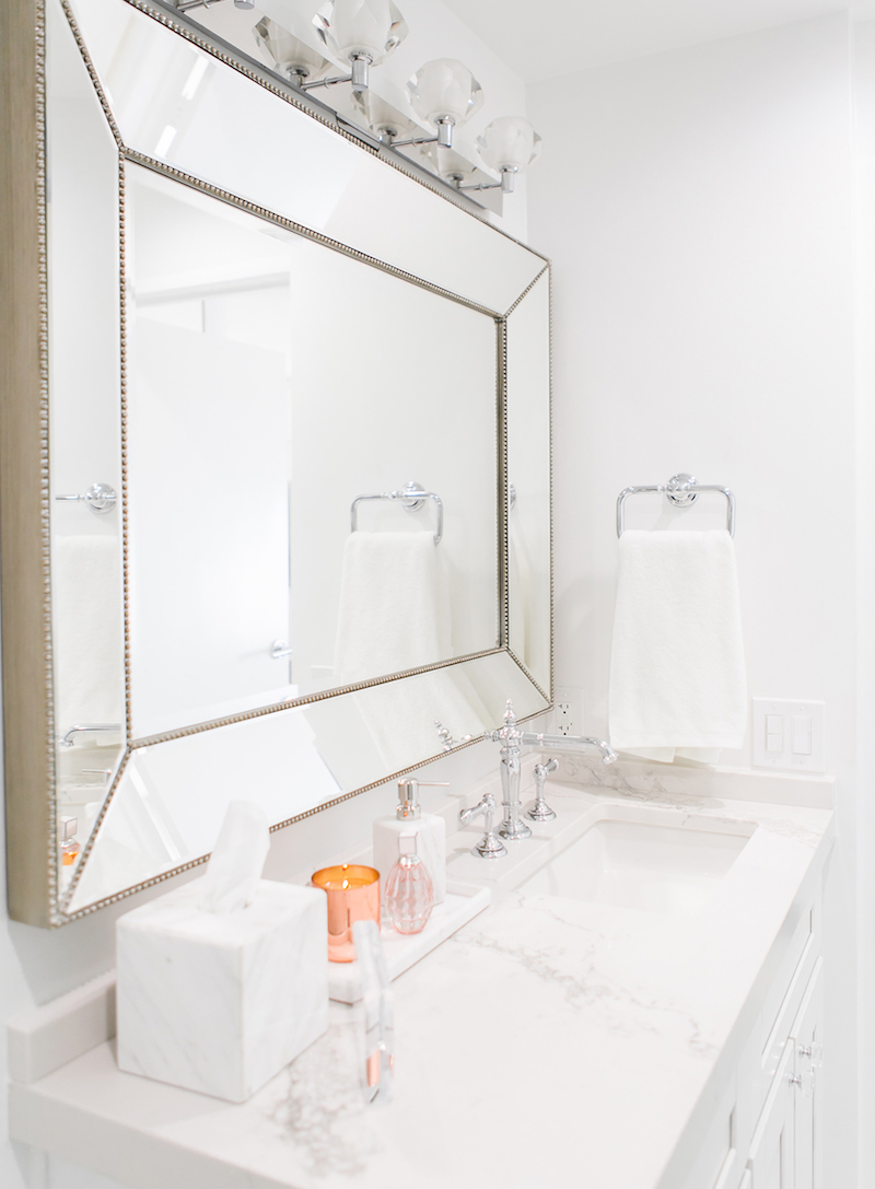 Silver frame mirror in white marble bathroom via Sydne Summer