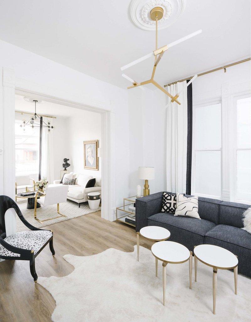 Three white nesting coffee tables via Shelby Girard