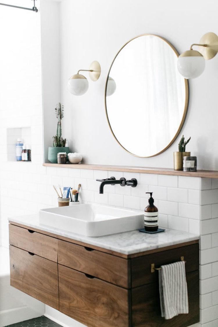 White Vessel Sinks on marble counter bathroom with gold mirror and brass sconces via SFGirlByBay