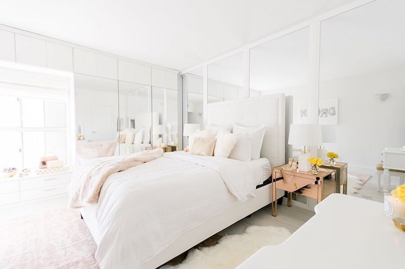 White bedroom with rose gold metallic nightstand via Sydne Summer