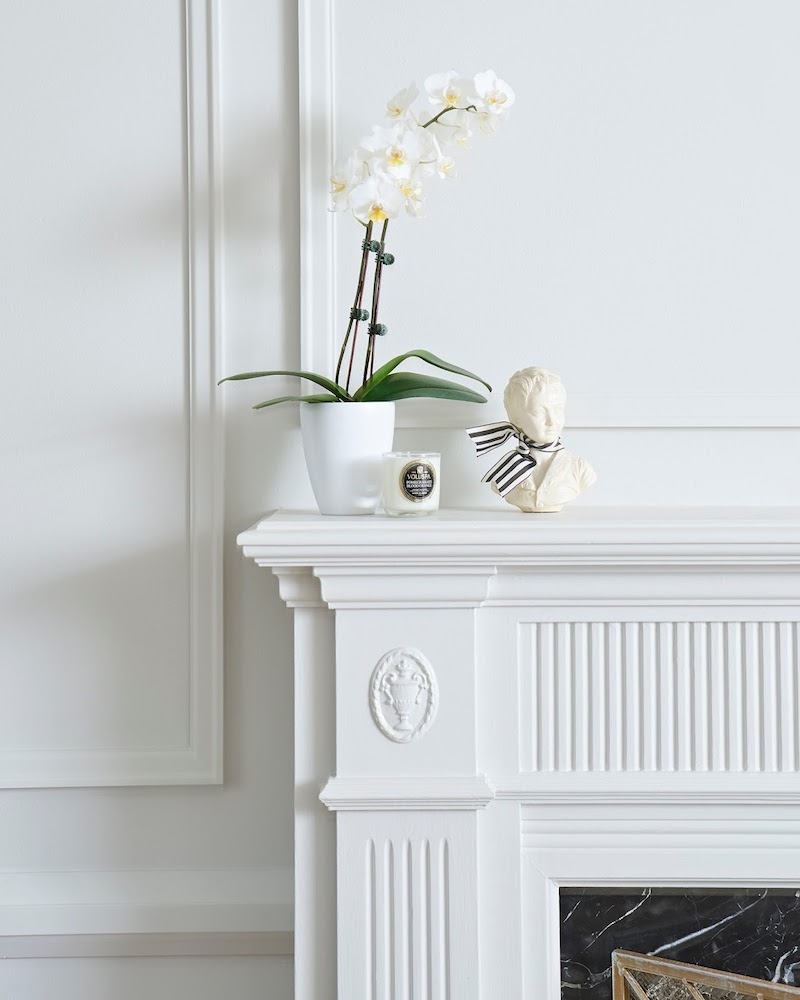 White bust in modern traditional colonial living room with painted moulding via Rambling Renovators