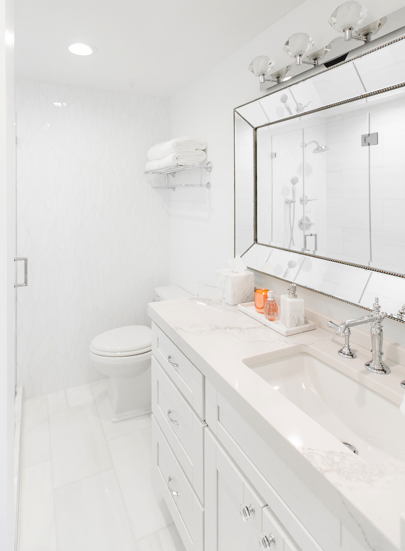 White marble countertop bathroom with silver fixtures via Sydne Summer