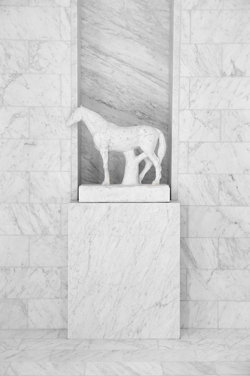 White marble horse on shower pedestal in Darryl Carter's Bathroom