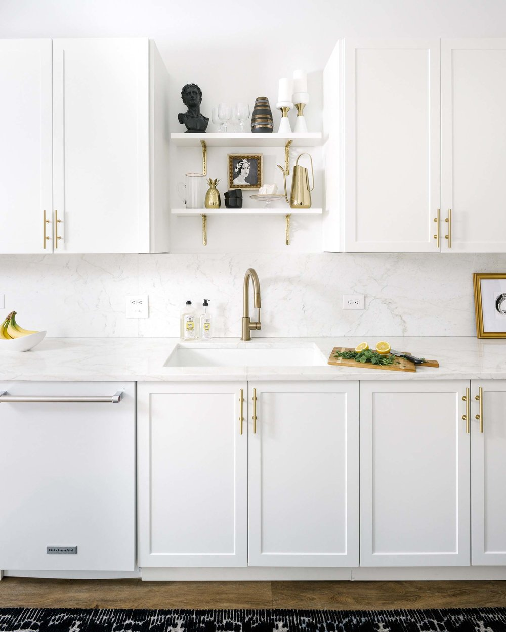 White marble kitchen with gold and brass hardware via Shelby Girard
