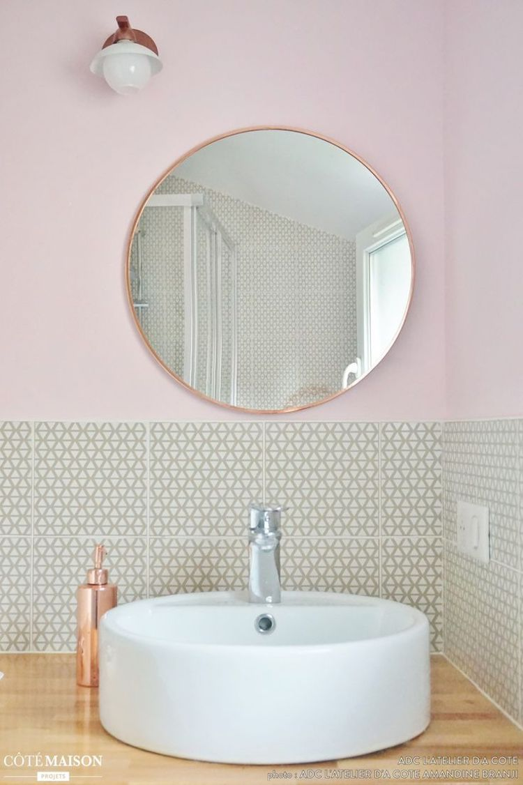 Copper bathroom mirror and copper soap dispenser in blush pink wall bathroom