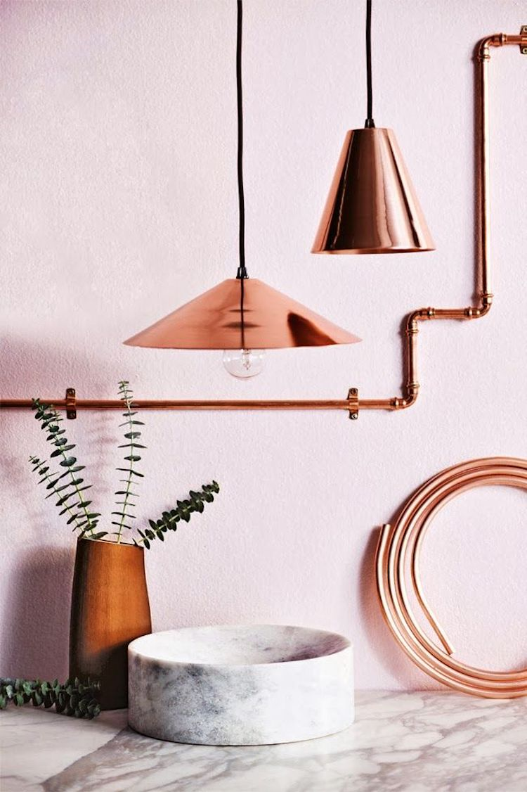 Copper pendants and accents against blush pink wall