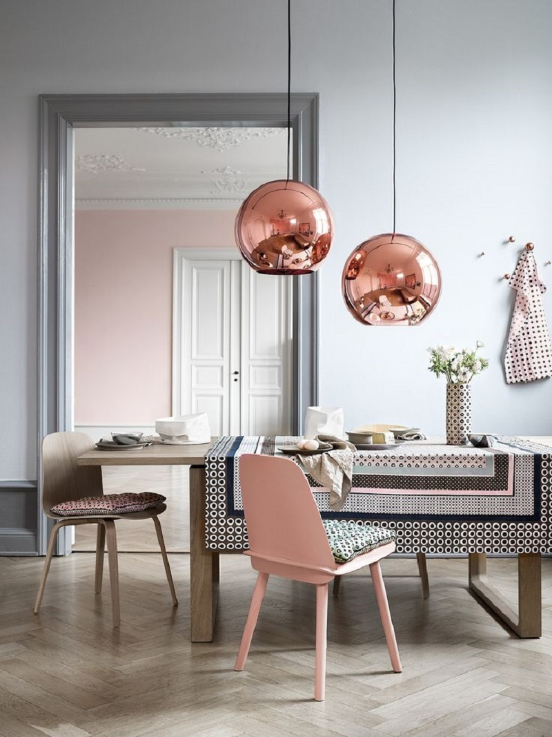 Copper sphere lighting over pink accent dining room table via Townsend London