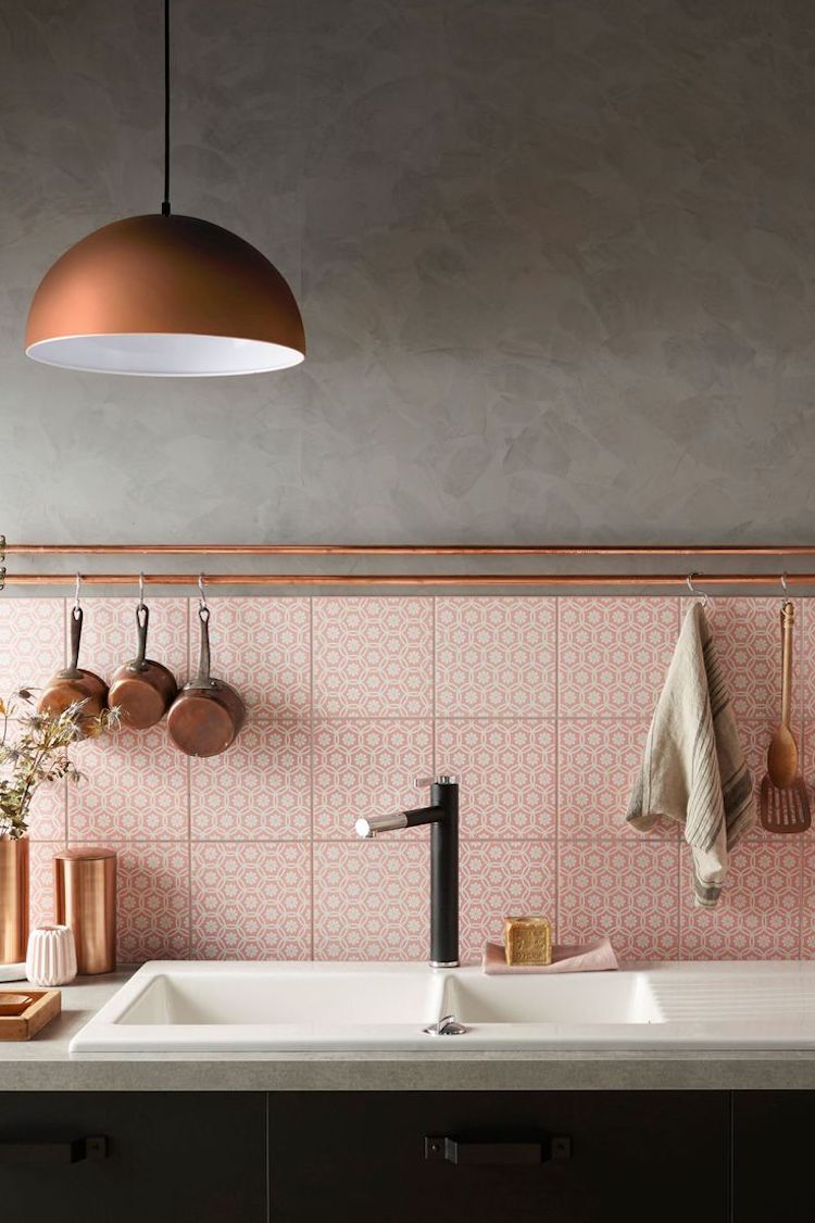 Kitchen with copper pendant and pink tile backsplash