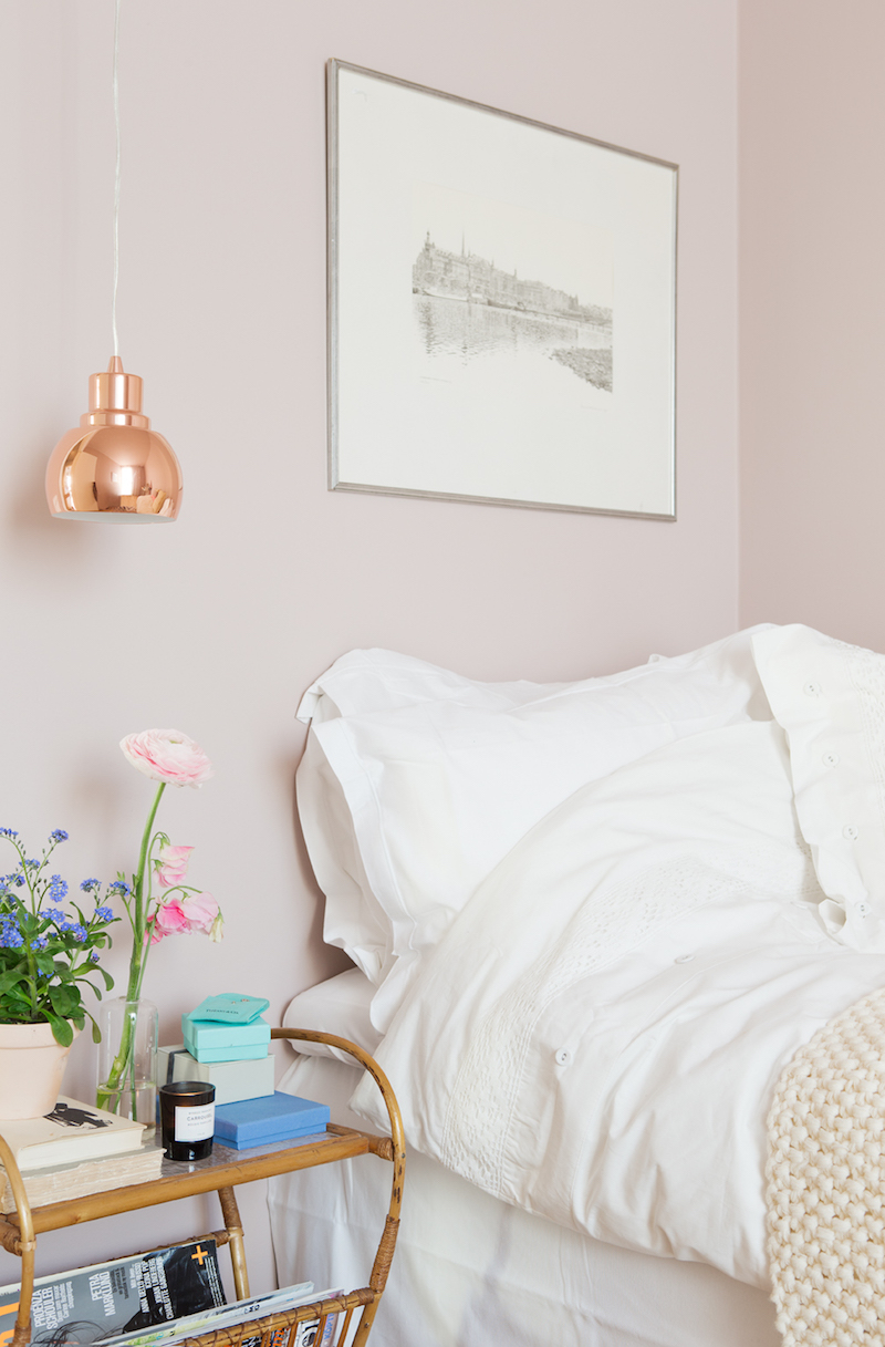 Soft pink bedroom walls with copper light via myamazingthings.com