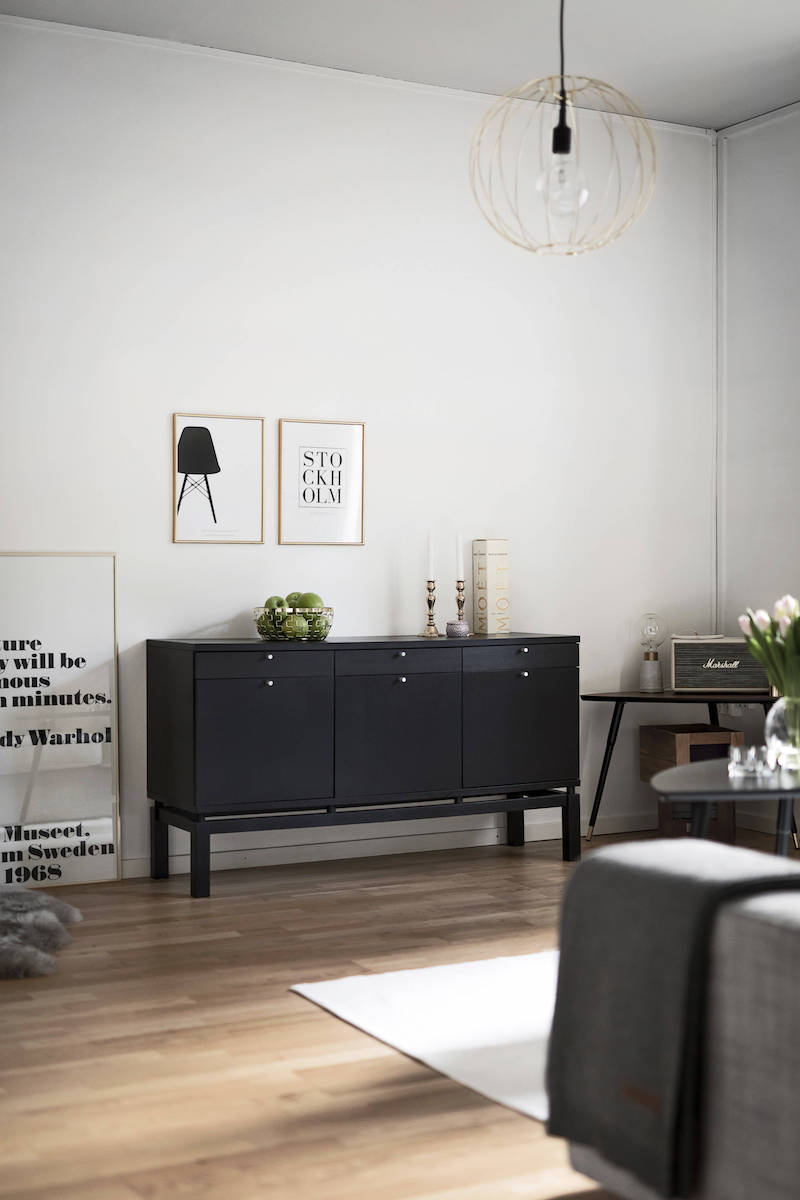 Dark brown sideboard in scandinavian living room